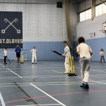 Junior cricketers playing an indoor match